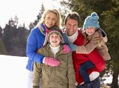 picture of pre-teen boy  - Young Family  In Alpine Snow Scene - JPG