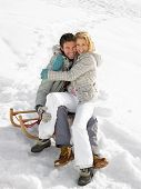 stock photo of toboggan  - Young Couple On A Sled - JPG