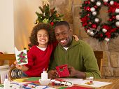 pic of card-making  - African American father and mixed race son making Christmas cards - JPG