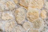 Old Weathered Bright Stone Wall Texture. Part Of A Stone Wall, For Background Or Texture poster