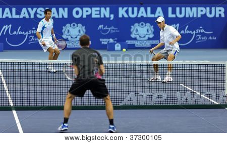 KUALA LUMPUR - SEP 25: Yew-Ming Si (white cap) partners Jimmy Wang in the doubles event at the ATP Tour Malaysian Open 2012 on September 25, 2012 at the Putra Stadium, Kuala Lumpur, Malaysia.