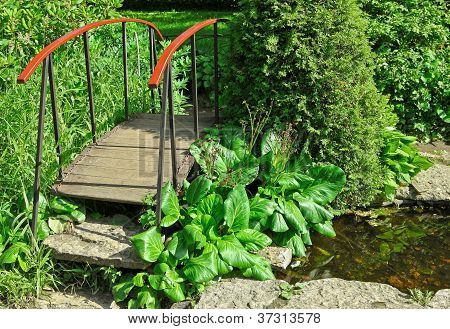 Little Wooden Bridge In A Garden
