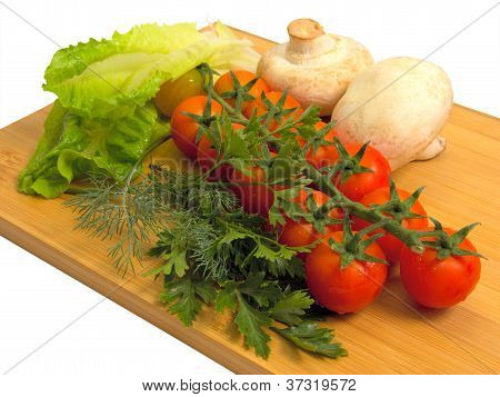 Raw Vegetables On Cutting Board