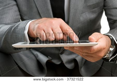 Closeup shot of businessman working on digital tablet