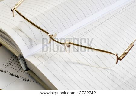 Glass And Notebook