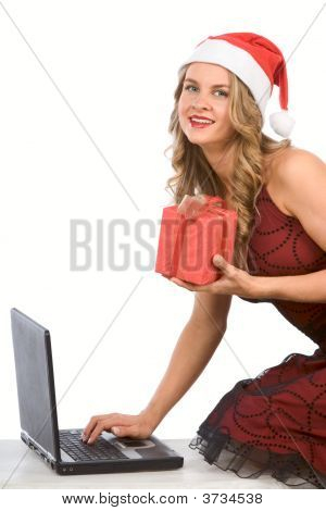 Sexy Mrs Santa Claus With Laptop And Giftbox