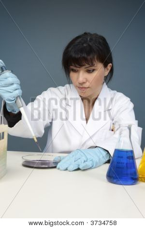 Scientist Extracting Sample