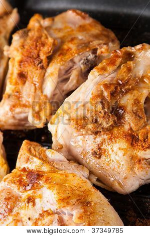Cook Chicken  With Spice On Frying Pan