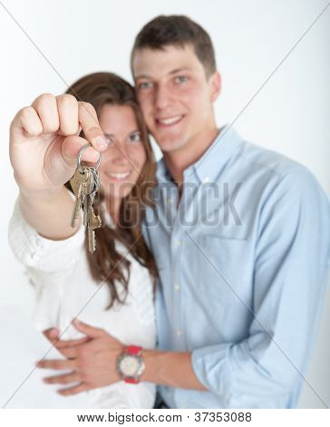 Young couple holding a bunch of keys