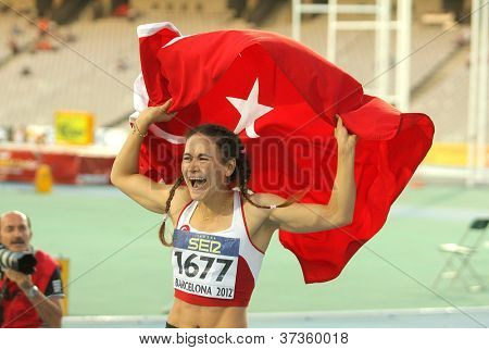 BARCELONA - JULY, 11: Nimet Karakus of Turkey celebrates silver medal of 100m event of the 20th World Junior Athletics Championships at the Olympic Stadium on July 11, 2012 in Barcelona, Spain