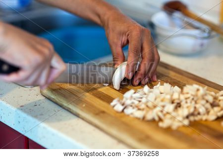 Woman's Hands Chopping Mushrooms