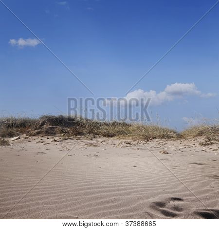 Dunes and sand dunes on a blue sky background