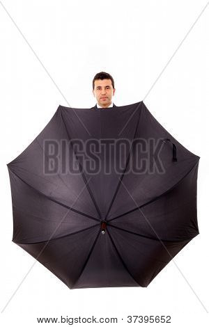 Business man hidden in umbrella against white background