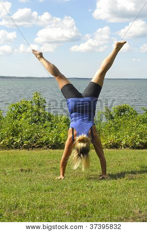 A Girl Doing A Hand Stand