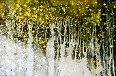 stock photo of gold glitter  - Abstract dripping pattern on an old wall with golden sparkles - JPG
