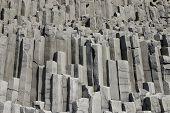 pic of prism  - Gray basalt prism shape stones at volcanic coast in Iceland - JPG