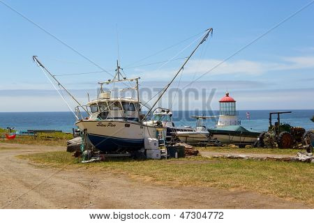 Shelter Cove, California, Usa - June 10. Lighthouse And Hauled Out Fishing Boat In Shelter Cove On J