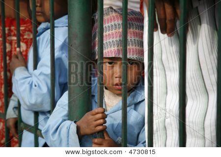 Boy Behind Bar