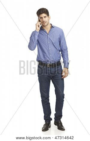 Young man talking on mobilephone. Full size.