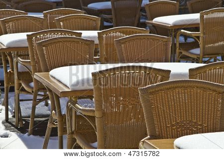 Chairs In The Summer Cafe, Covered With Snow.