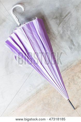 Purple Uv Protection Umbrella On The Floor