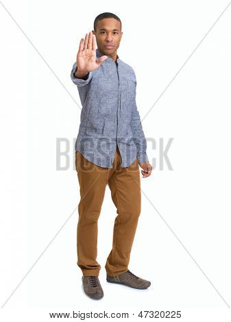 Young African Man Showing Stop Sign With Hand Over White Background