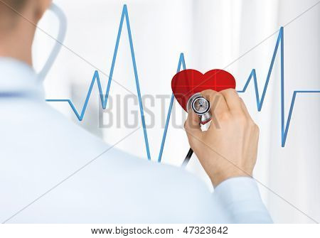 doctor with stethoscope listening heart beat on virtual screen