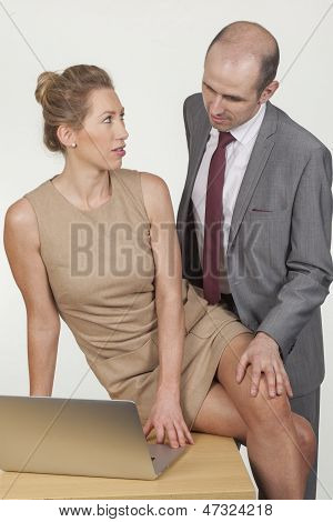 Boss Harassing A Female Colleague