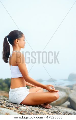 yoga beach woman doing pose at the ocean for zen health and peaceful lifestyle