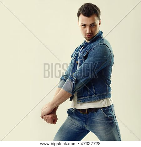 Portrait of handsome fashion young man in jeans
