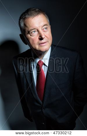 Man in studio with red tie