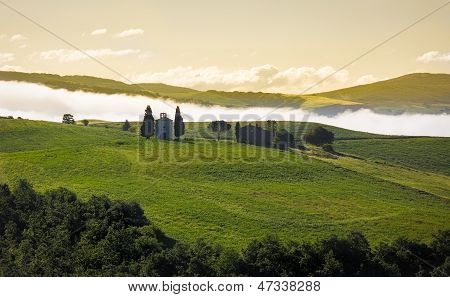 Tuscany landscape in morning mist, Val d'Orcia, Italy