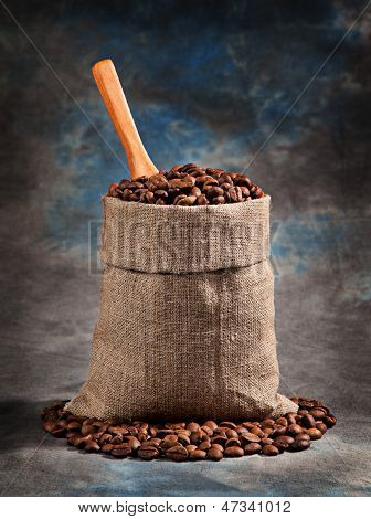 Roasted Coffee Beans In A Bag With A Scoop