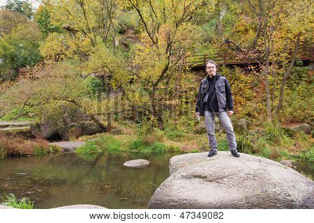 Man In Autumn Forest With River