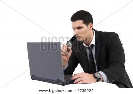 Businessman With Lap Top Computer And Phone