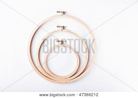 Three Needlework Embroidery Hoops On White Background