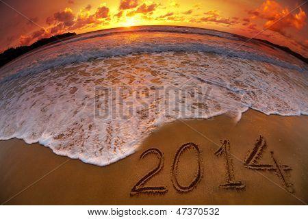 new year 2014 digits on ocean beach sunset