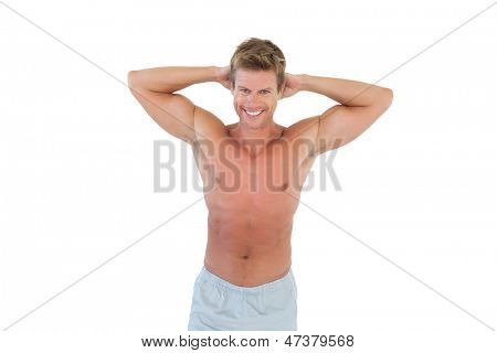 Shirtless man with hands on head on white background