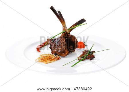 image of grilled ribs served over big white plate
