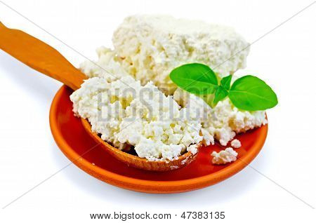 Curd In A Wooden Spoon And A Clay Plate