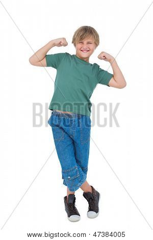 Happy blonde boy tensing arm muscles on white background