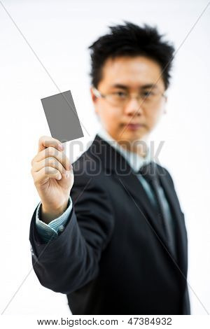 Businessman holding business name card isolated over white background (selectice focus)