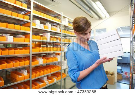 Drugstore Employee Searching For Medicine