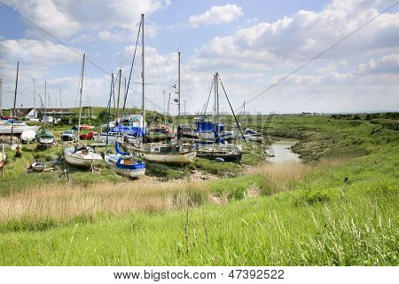 Boats moored on the banks of the river