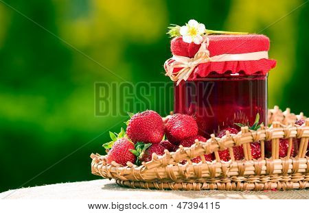 Red Strawberries And Jam In The Basket