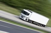 picture of car carrier  - White truck on highway  - JPG
