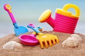 Summer beach toys in the sand