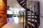 picture of spiral staircase  - Spiral stairs and living room in modern loft - JPG