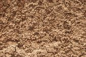 foto of loam  - Red dry clay loam closeup as background - JPG