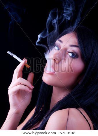 Portrait Of Elegant Smoking Brunette